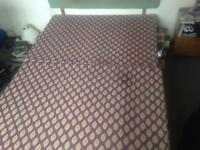 Double bed with storage cupboard
