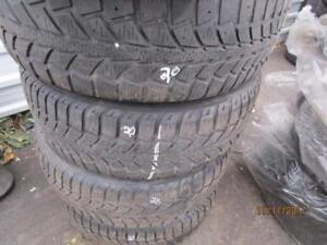 195/65R15 SET OF 4 USED UNIROYAL WINTER TIRES ON FORD FIESTA RIMS
