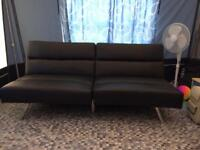 Black click clack bed settee sofa in Tenby