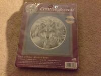 Cross stitch kit, circle of wolves