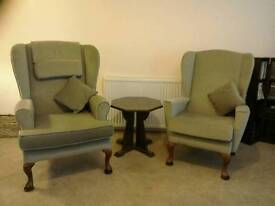 Two sage green armchairs, matching footstool