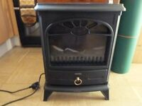 Warmlite electric coal effect fan heater. Good condition, used twice.