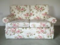 Sofa, two seater from Hopewells. Cream with pink flowers . Moving house so need to sell