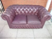 A Burgundy Leather Chesterfield Two Seater Sofa Settee