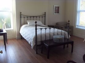 Room available in quiet north Belfast street - large luxury house.
