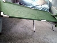 Large camp bed with storage bag