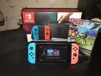 Nintendo Switch Neon Blue and Neon Red + 2 Games (Legend Of Zelda Breath Of The Wild & Mario Kart 8)