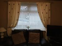 Two pairs of cream curtains and five cushions excellent condition