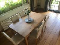 Wooden dining table with 5 matching chairs