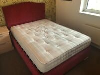 Red double bed and mattress