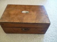 Antique wooden box with inlaid mother of pearl.