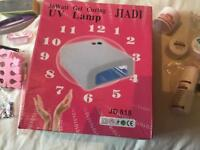 Brand new nail extension set and uv lamp