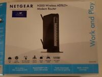Netgear N300 Wireless ADSL2+ Modem Router in box - used -