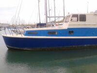 Inexpensive home for sale ...... a houseboat ! Visit me at Brighton Marina Boat Jumble