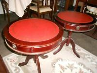 A PAIR OF VINTAGE REPRODUCTION RED LEATHER TOPPED MAHOGANY DRUM TABLES