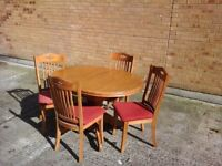 Lovely table and 4 chairs. chair seats can easily be recovered too.