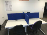 5 sets of desk pods consisting of 4 desks per pod with dividers and 20 office chairs.