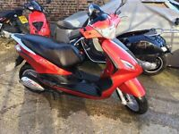 Tidy Red Piaggio Fly 50