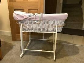 Lovely pink Claire de lune moses basket with sheets and blankets