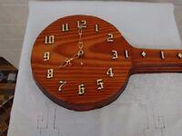 Banjo shape clock