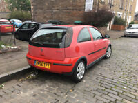 Red Vauxhall Corsa, £900 ONO, 56,000miles, MOT until August 2019, 2 female drivers since new