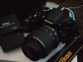 Nikon D3200 DSLR, 24.2MP, with remote, spare battery, charger and case