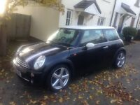 Superb black Mini Cooper 1.6..... immaculate condition..... 10 months mot.....new tyres..........