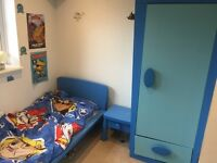 Complete child's bedroom set including bed, wardrobe, chest of drawers and bedside table