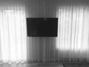Installation de tv au mur - Support télé INCLUS