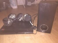 LG Dvd surround sound player, 5 speakers and sub woofer, scart cable connected