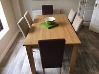 Wooden Dining Table + 6 Fabric Chairs - Furniture Village £999!