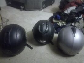 Three second hand motorbike helmets.