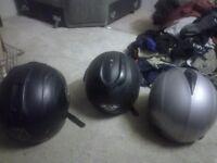 Three second hand motorbike helmets.