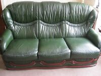 Three seater sofa, chair and foot stool in green leather