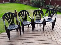 Four Green Plastic Garden Chairs