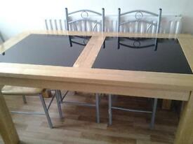 dining table.solid oak with glass inlays.cost£800, 6months old