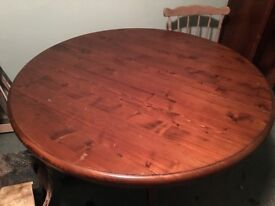 Large circular solid wood dining table