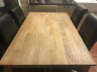 Oak extending table with 4 faux leather chairs.