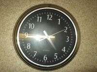 large kitchen wall clock black face with silver surround in perfect working order