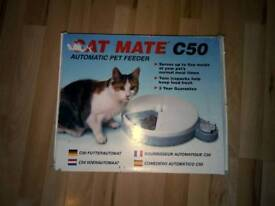 Cat mate automatic cat feeder. New condition, still with the box.