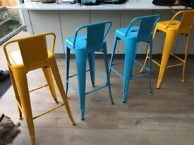 2 yellow and 2 light blue/turquoise industrial style bar stools
