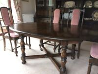 Ercol extending dining table in solid elm