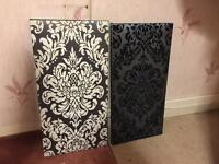 2 black and white canvas pictures in good condition