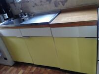 retro kitchen, yellow/white, formica worktop, used but still fine. needs some tlc. collection only.