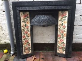 Victorian cast iron fire surround with flowered tiles