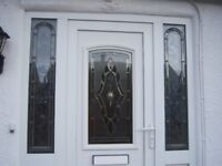 TWO WHITE UPVC DOORS - FRONT DOOR WITH FEATURE GLASS PANEL (NO FRAME) - PORCH DOOR OBSCURE GLASS.