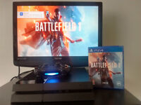 PS4 console with wireless controller and BATTLEFIELD 1