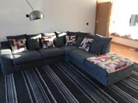 Grey fabric corner sofa and cuddle chair. Very modern design