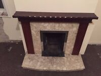Fireplace, including hearth, mahogany surround and marble inset
