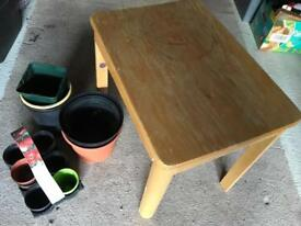Small table and plastic pots